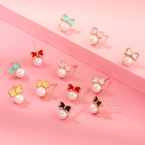 boucles d'oreilles simples avec nœud papillon NHNU351780's discount tags