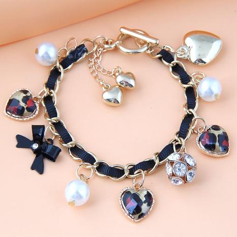 Fashion metal pearl love metal leopard bow knot bracelet NHSC350976's discount tags