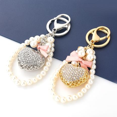 Porte-clés chaîne de perles en alliage de diamant en alliage en forme de coeur d'amour coréen NHJE351338's discount tags