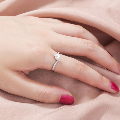 fashion simple diamond-studded copper zircon pure white pearl ring NHAN355598's discount tags