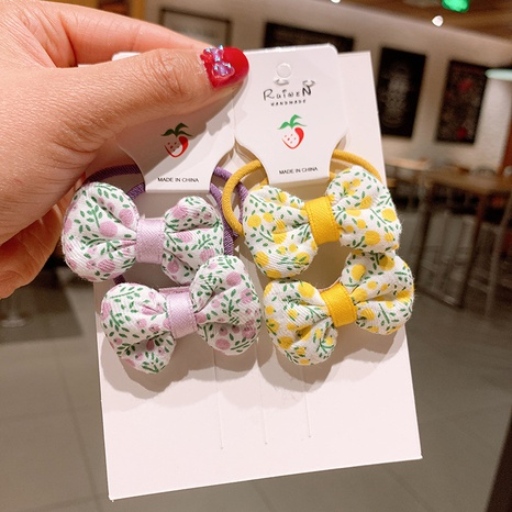Koreanische Art Blumenbogen Haarseil Großhandel NHSA355776's discount tags