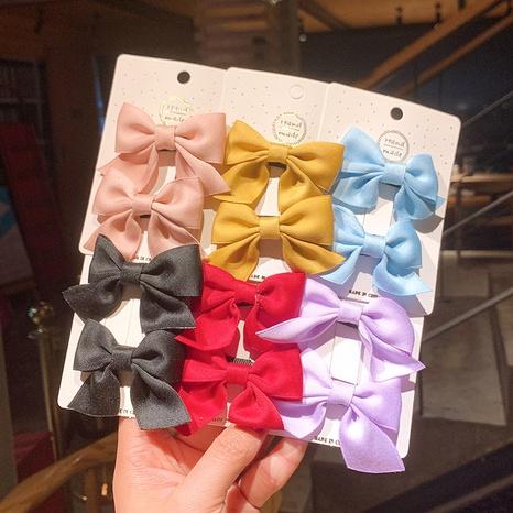 Einfarbige Kinderbogen-Haarnadel im koreanischen Stil NHSA355777's discount tags