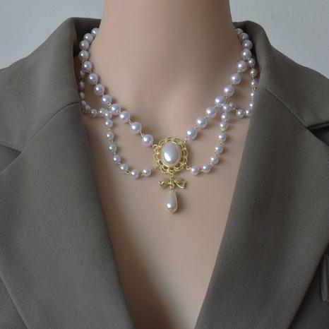collier rétro à pampilles en perles multicouches NHNT356964's discount tags