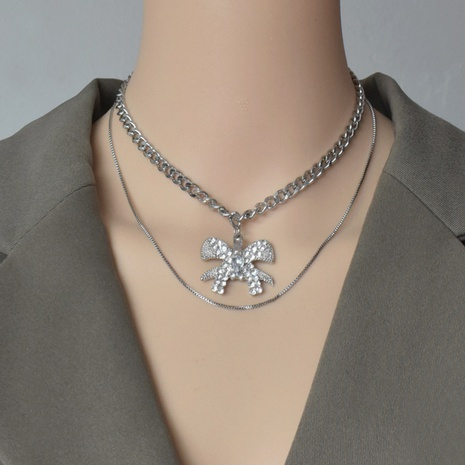 Collier double couche empilé Bowknot NHNT356974's discount tags