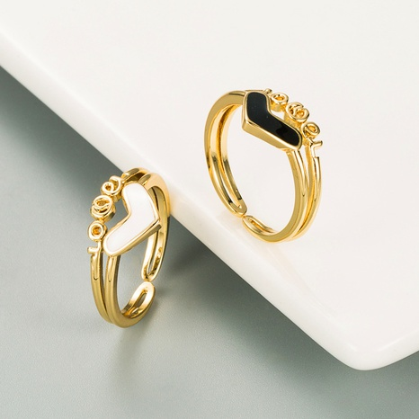 Copper-plated 18K gold RINGS LOVE love black and white dripping oil ring  NHLN359383's discount tags