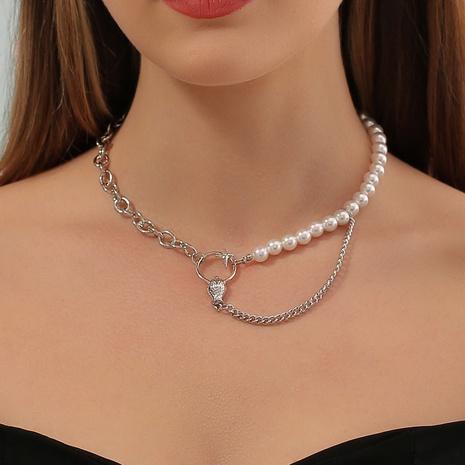 Al por mayor collar de cabeza de serpiente con costura de perlas asimétricas de moda NHDP344828's discount tags