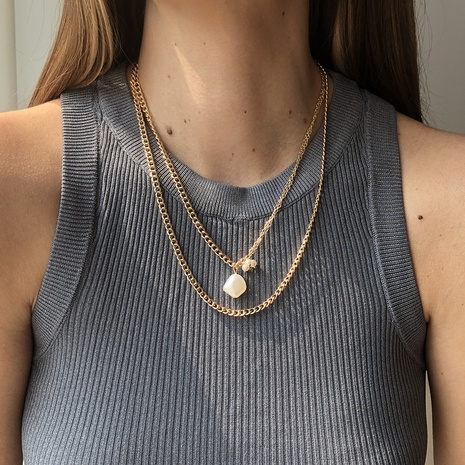 Cadena de clavícula de doble capa colgante de perlas de imitación en forma especial de moda NHMD344839's discount tags