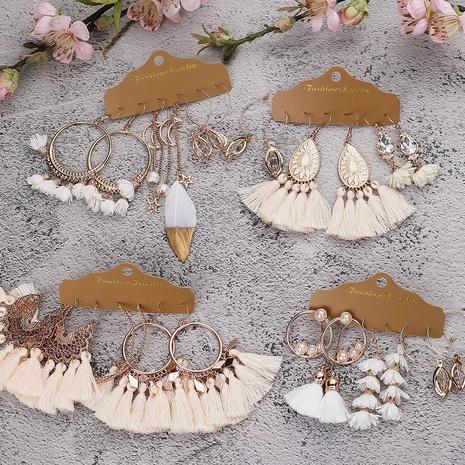 ethnic alloy big round beige white tassel earrings set  NHAKJ345227's discount tags