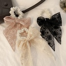 Korea flower bow knot hollow rubber band hair accessories NHCQ345237