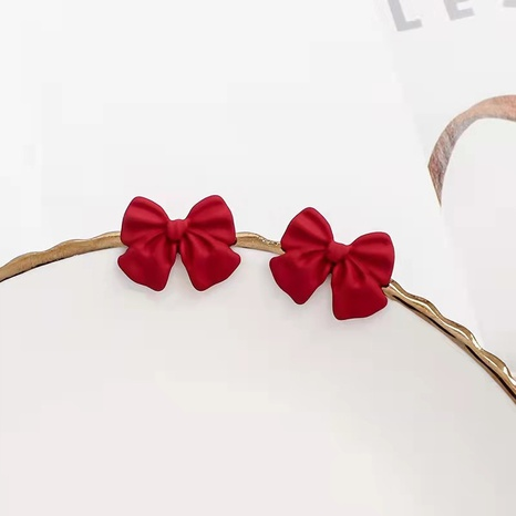 Fashion bow frosted paint earrings wholesale NHDQ345839's discount tags