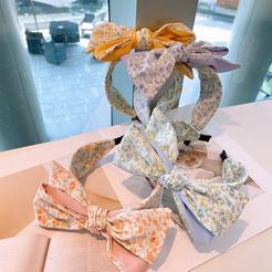 Koreanische kleine Blumen mehrschichtige dreidimensionale Bogen Stirnband Großhandel NHHD345934