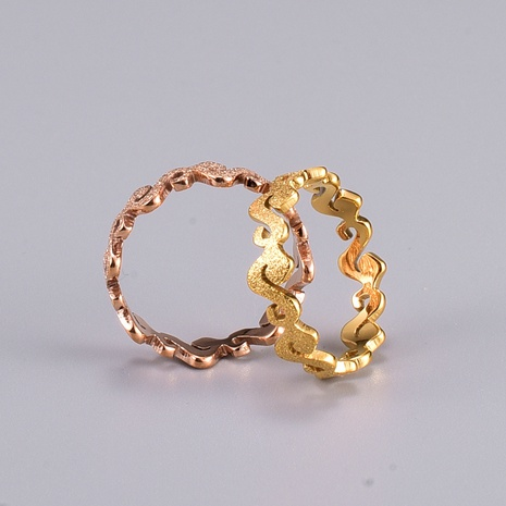 Wholesale Fashion Gold Pressed Sand S-shaped Titanium Steel Ring NHAB346023's discount tags