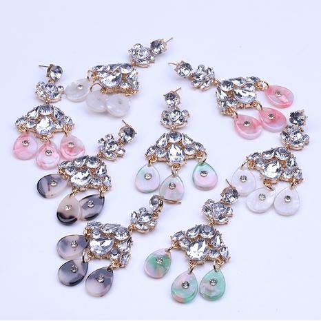 Al por mayor pendientes plateados de diamantes de imitación de aleación de moda NHYAO346124's discount tags