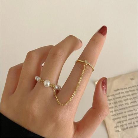 anillo de circonita perla ajustable de una pieza con diseño geométrico retro NHYI346214's discount tags