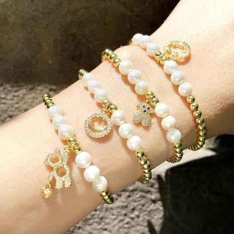 Pulsera elástica de circonitas de cobre con cuentas de perlas NHAS366238's discount tags