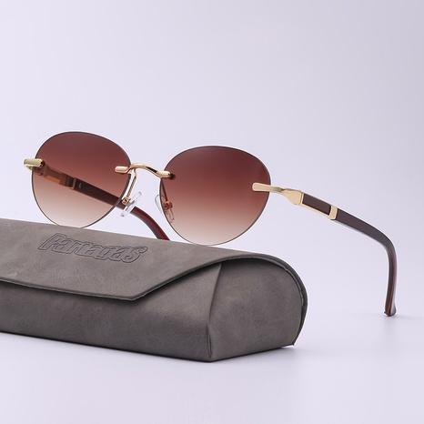 Gafas de sol redondas sin montura de moda al por mayor NHLMO366353's discount tags