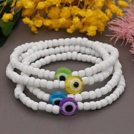 Korean Style White Glass Beads Glass Eye Bracelet Wholesale NHYUX367359's discount tags