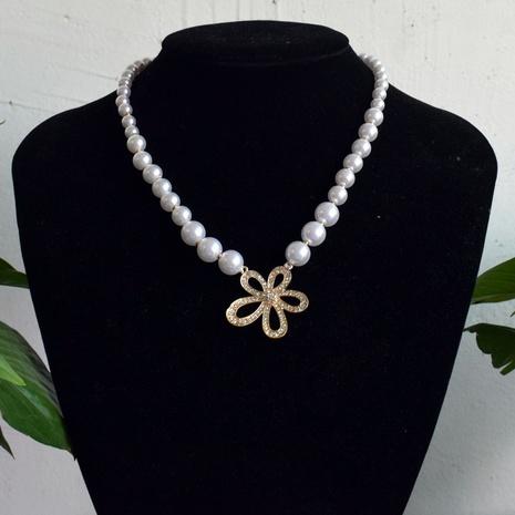 Collier de perles d'arc de fleur de diamant de mode en gros NHNT367803's discount tags