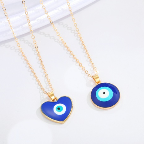 collar de resina colgante de ojo de diablo redondo de corazón de melocotón de moda NHGO368228's discount tags