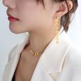NHOK1705784-F476-pair-of-golden-texture-earrings