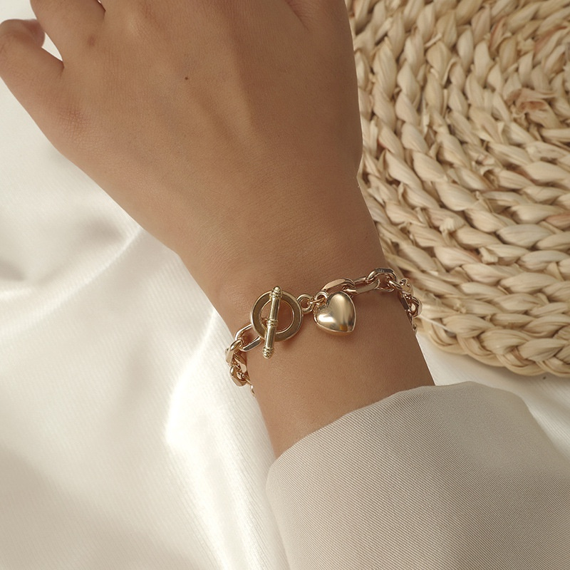 fashion metal twist chain OT buckle heart shape pendant bracelet NHKQ369231