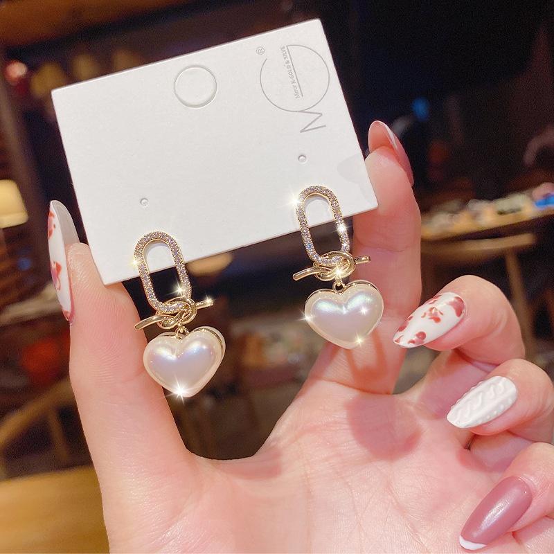 Korean style simple heart shape pearl earrings  NHXI370257