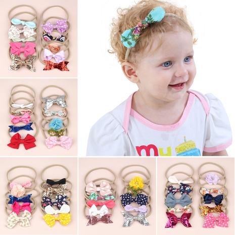Bande de caoutchouc en nylon avec oreilles de lapin florales pour enfants NHWO371068's discount tags