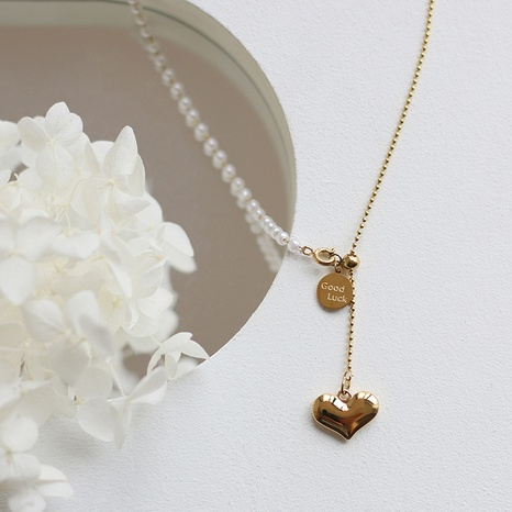 Collar de acero de titanio con perlas y borlas largas de corazón coreano NHGC371449's discount tags