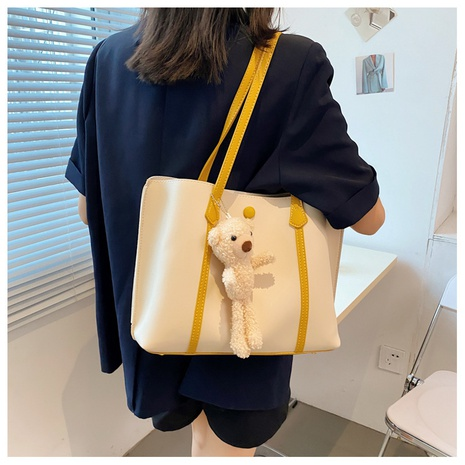 fashion large-capacity one-shoulder armpit bear pendant tote bag NHWH371557's discount tags