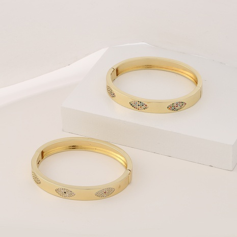 Retro geometric copper micro-inlaid zircon eyes bracelet  NHBU372756's discount tags