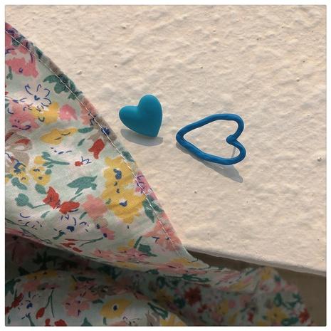 Nihaojewelry jewelry wholesale blue peach heart asymmetrical stud earrings  NHOT374543's discount tags