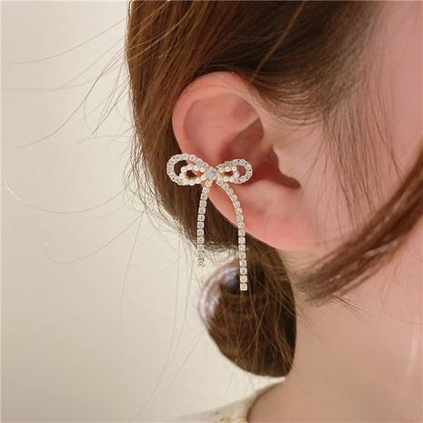 Nihaojewelry Schmuck Großhandel Doppelschicht Bowknot Quaste Ohrclip NHOT374539's discount tags
