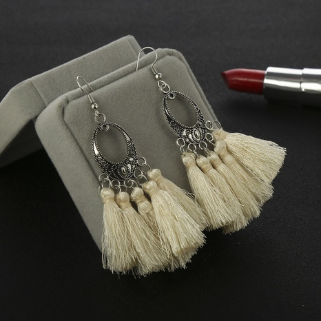 Nihaojewelry ethnic style alloy hollow carved oval long tassel earrings Wholesale jewelry NHGY374476's discount tags