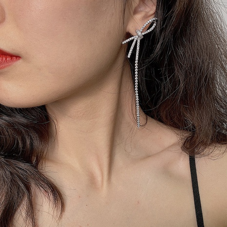 Simple asymmetrical bow zircon long tassel copper earrings  NHGI372897's discount tags