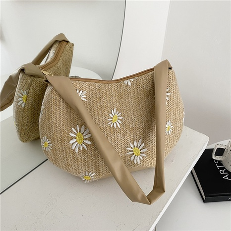 Korean casual chrysanthemum shoulder straw woven bucket bag wholesale NHRU373909's discount tags