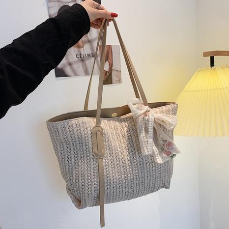 Korean simple silk scarf large-capacity shoulder straw woven bag wholesale NHRU373912's discount tags