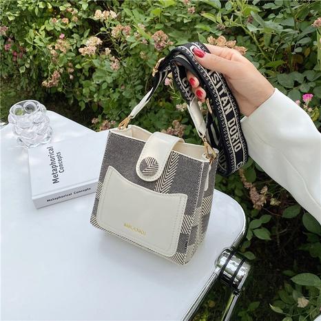 Korean fashion letter handle messenger bucket bag wholesale NHJZ374208's discount tags
