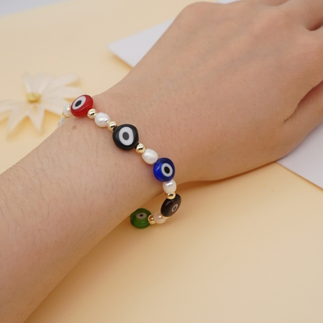 Nihaojewelry bohemian style pearl eye beads bracelet jewelry Wholesale NHYUX374639's discount tags