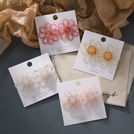 Großhandel Schmuck handgewebte Kristall Gänseblümchen Ohrringe Nihaojewelry NHMS374784's discount tags