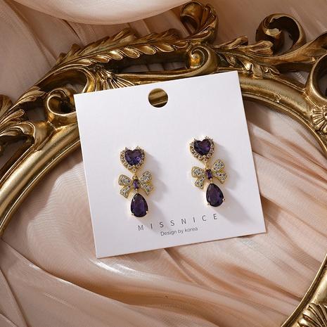 Großhandel Schmuck Amethyst Bogen Kupfer Ohrringe Nihaojewelry NHMS374785's discount tags