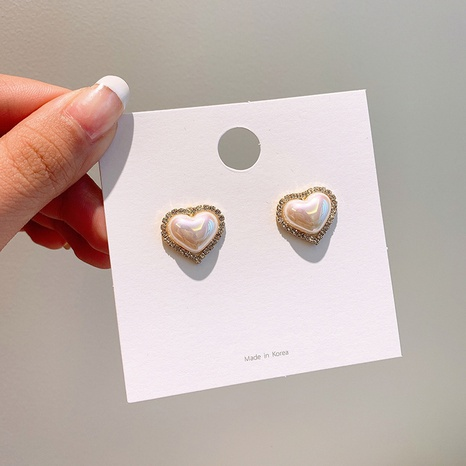Al por mayor joyas simples pendientes de perla con incrustaciones en forma de corazón nihaojewelry NHPA375059's discount tags