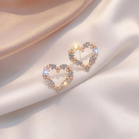 Al por mayor joyas simples pendientes de diamood con incrustaciones en forma de corazón nihaojewelry NHPA375083's discount tags