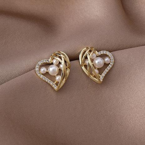 Al por mayor joyería coreana corazón perla pendientes de cobre huecos Nihaojewelry NHMS375139's discount tags