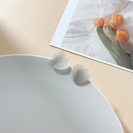 wholesale joyas Pendientes de corazón transparente de ópalo Nihaojewelry NHGQ375502's discount tags
