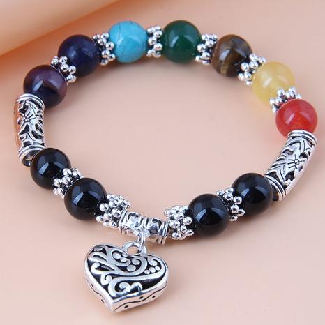 Nihaojewelry jewelry wholesale metal peach heart pendant colrful beads bracelet NHSC376086's discount tags