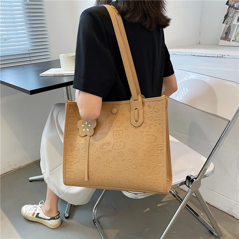 wholesale accessories solid color embossing tote bag Nihaojewelry NHTG375885's discount tags