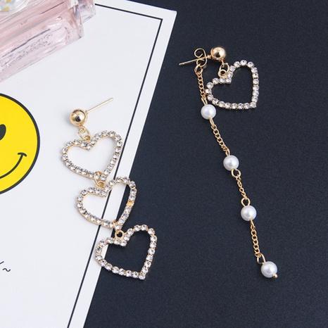 Pendientes largos de perlas de diamantes de corazón hueco al por mayor de joyería de Nihaojewelry NHQC376592's discount tags