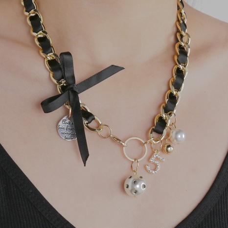 Collier noeud papillon tressé en cuir noir coréen NHHF363499's discount tags