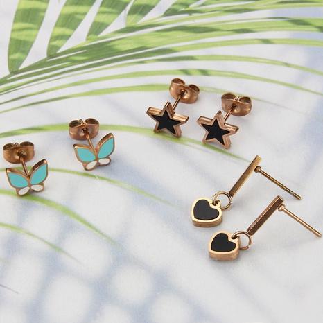 boucles d'oreilles en forme de coeur papillon acrylique simple à cinq branches NHBP363514's discount tags