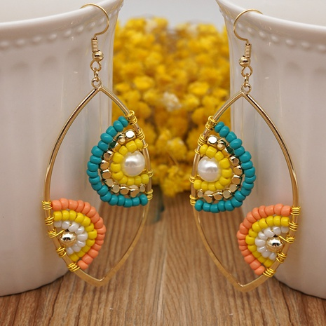 Fashion Devil Eyes Glass Bead Pearl Earrings Wholesale NHYUX363682's discount tags